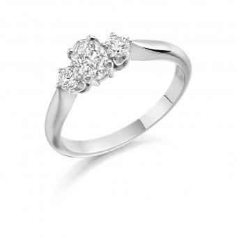 Platinum Teresina oval and round cut diamond three stone ring 0.50