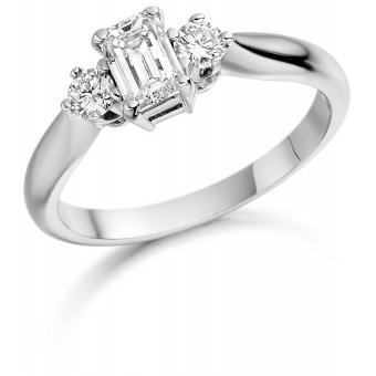 Platinum Teresina emerald and round cut diamond three stone ring 0.69cts