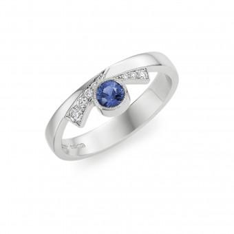 Platinum Deco inspired rub over set round Ceylon sapphire and round cut diamond milgrain set Bow ring.