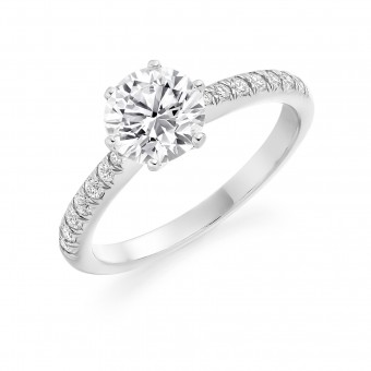 Platinum Caterina round cut diamond solitaire ring, diamond shouders 0.72cts