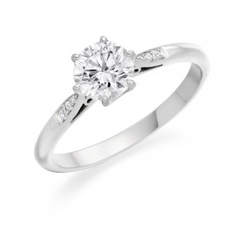 Platinum Serafina round cut diamond solitaire ring, diamond shoulders 0.35cts