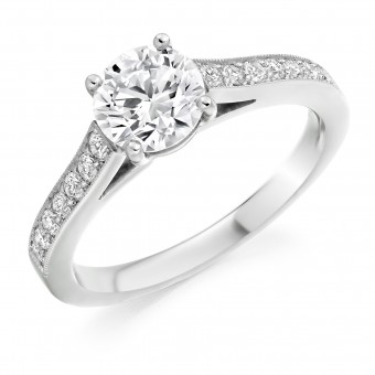 Platinum Nuovo Duplice round cut diamond solitaire ring, diamond shoulders .90cts