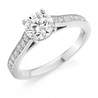 Platinum Nuovo Duplice round cut diamond solitaire ring, diamond shoulders 0.60cts