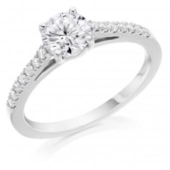Platinum Pianeti round cut diamond solitaire ring, diamond shouders 0.68cts