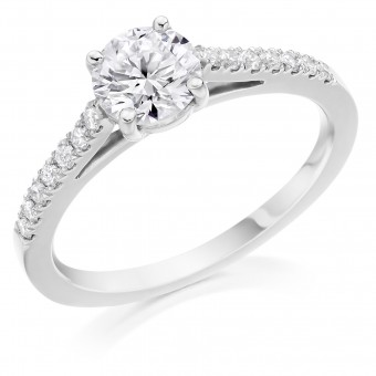 Platinum Pianeti round cut diamond solitaire ring, diamond shouders 1.11cts