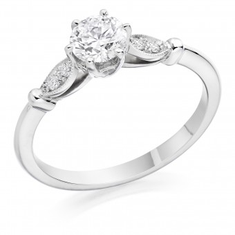 Platinum Lily round cut diamond solitaire ring, diamond shoulders 0.58cts