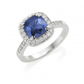Platinum vintage style cushion cut sapphire  and diamond halo ring, diamond shoulders