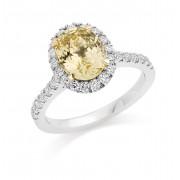 Platinum & 18ct gold Pianeti oval cut yellow sapphire  and diamond halo ring, diamond shoulders