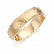 Eighteen carat champagne coloured gold 6mm Cotswold hammered finish wedding ring